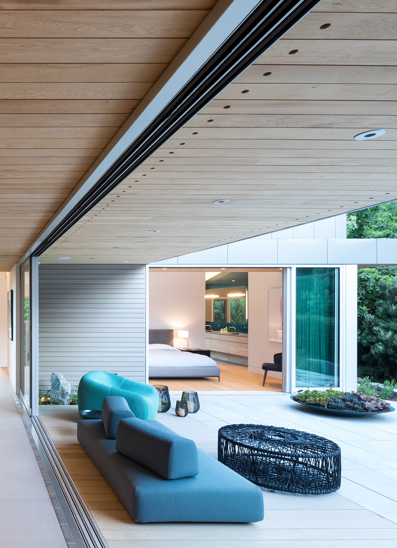 Large sliding panel doors opens up into outdoor patio space