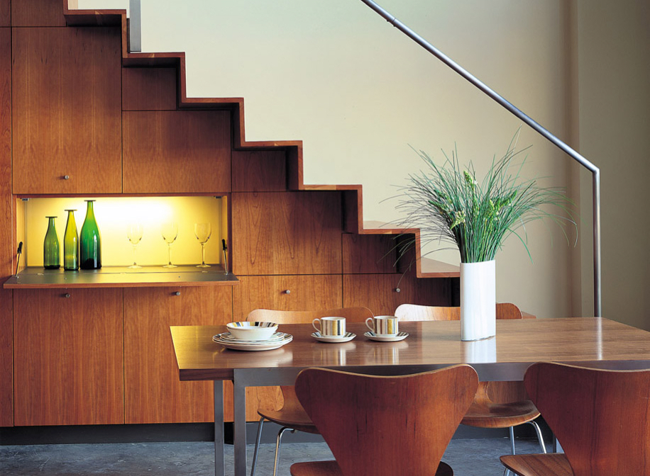 Dining area and staircase in modern loft space.
